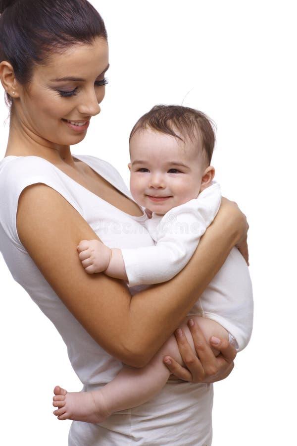 Embrassement de mère et de bébé image libre de droits