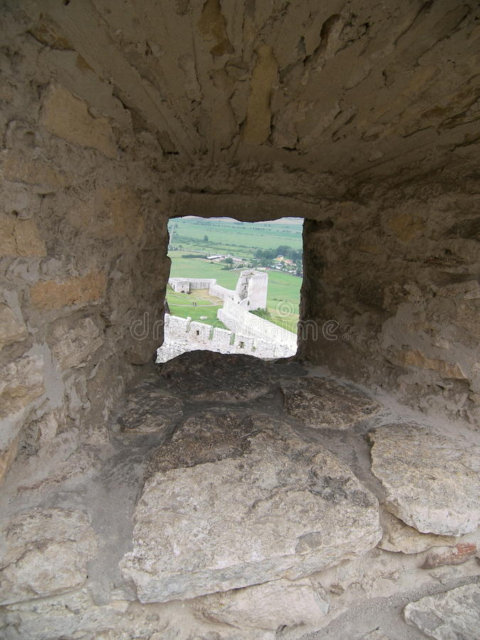 Embrasure in a castle wall stock photography