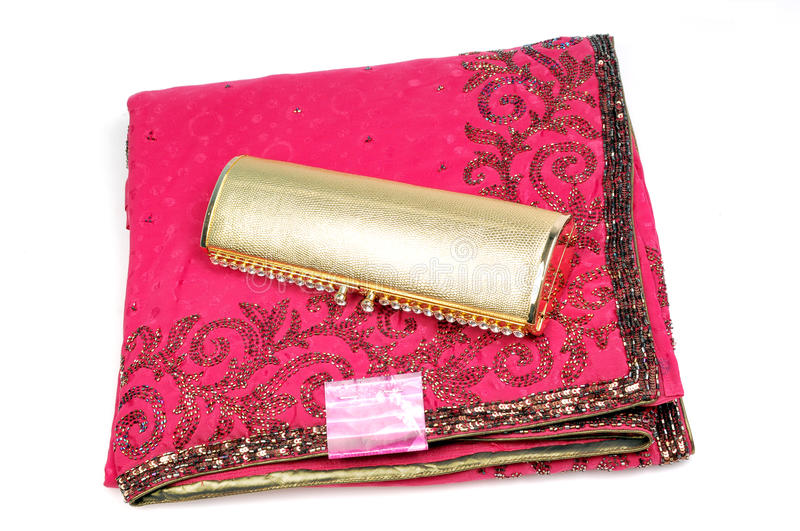 Embroided pink saree with golden purse royalty free stock photos