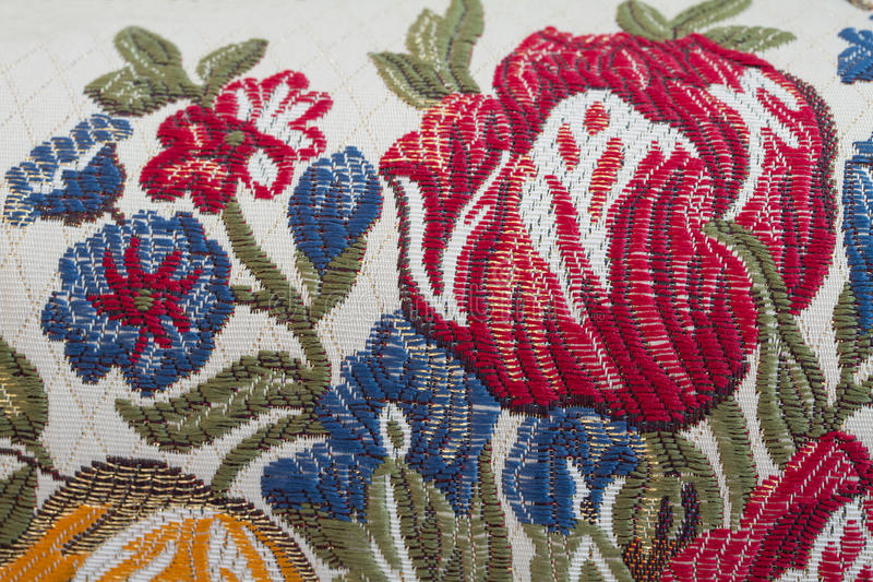Embroider flower. On fabric texture stock photos