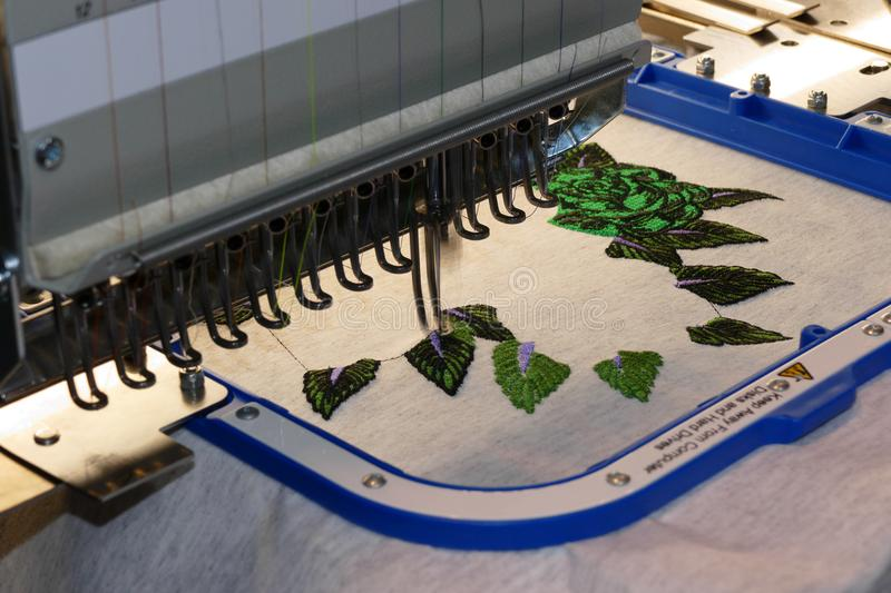 Embroider machine detail. Cnc embroider machine head detail royalty free stock photo