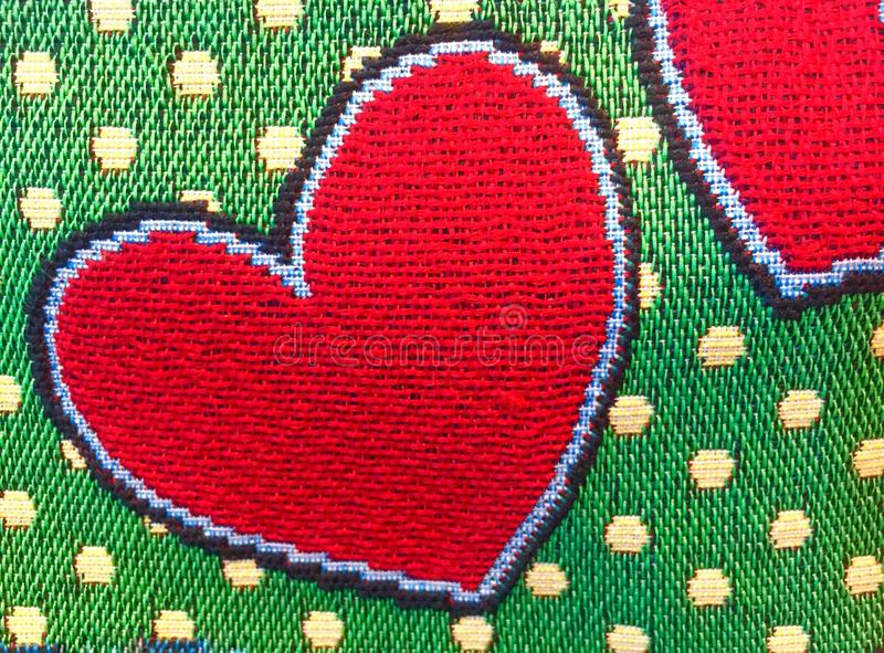 Embroider heart. Embroider red heart pattern on fabric stock image