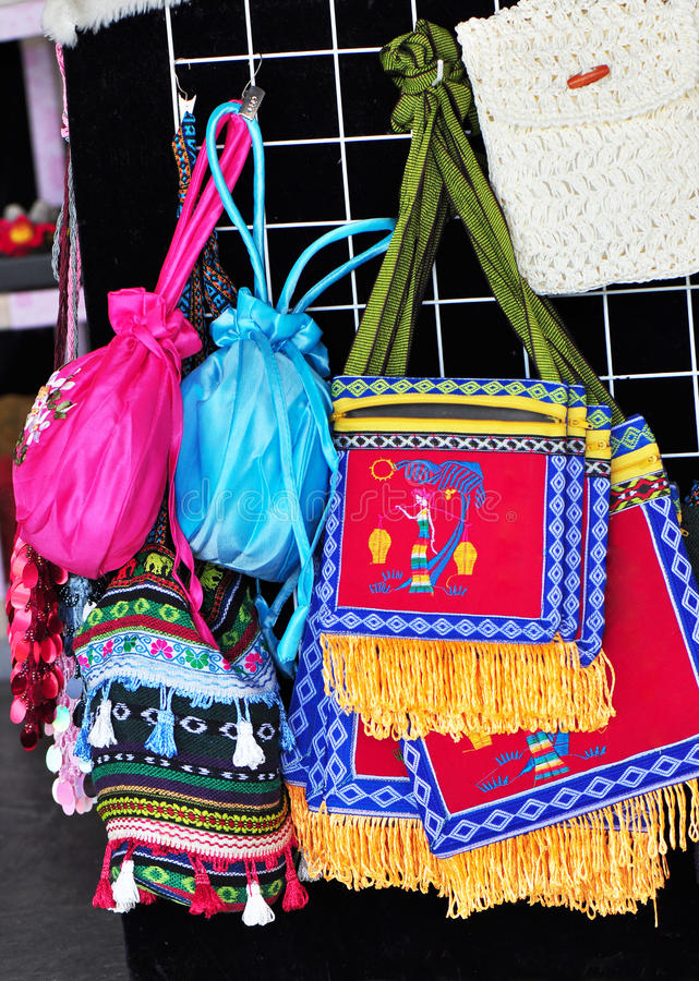 Embroidered bags. Colourful embroidered bags on sale stock images