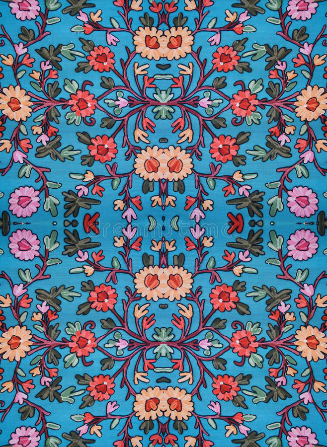 Embroidered floral pattern on the fabric. The combination of parts photo stock images