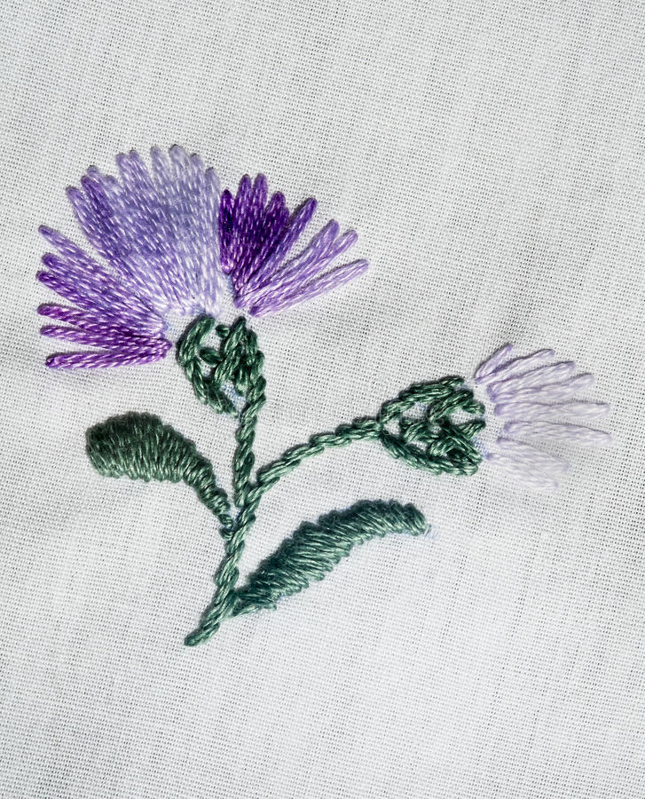 Embroidered flowers. Embroidered handmade colorful flower design stock image