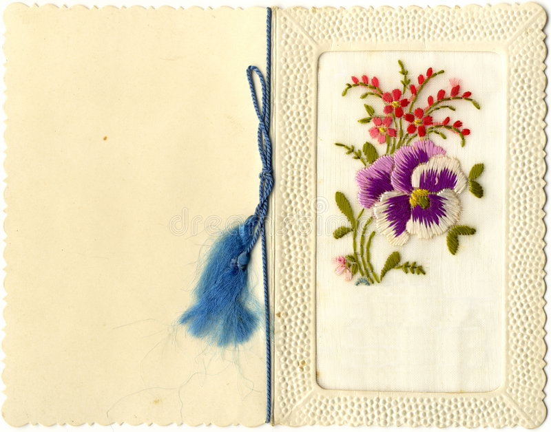 Embroidered Greeting Card. Beautiful Vintage French Greeting Card with blue ribbon, 1930s A piece of embroidered fabric in a frame of goffered paper. My stock photography