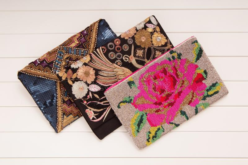 Embroidered handbags, three handbags with embroidery, clutches o stock images