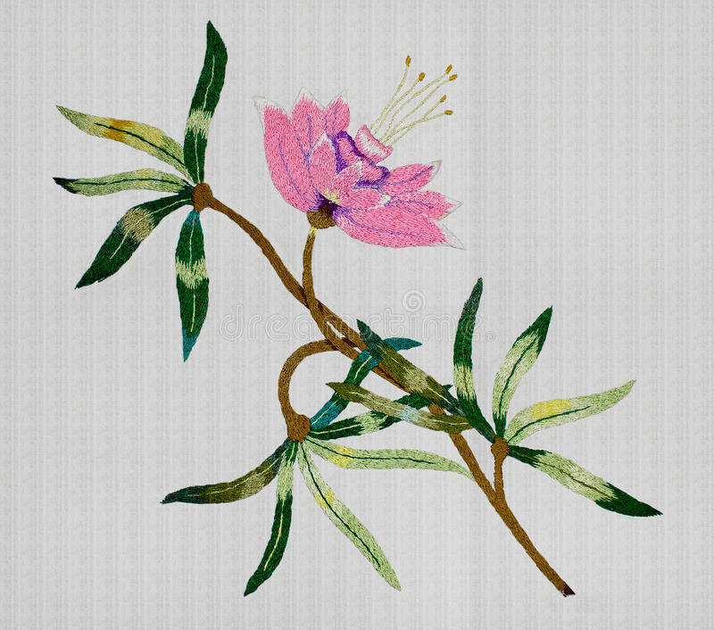 Embroidered pink flower. White background with embroidered pink flower closeup royalty free stock photo