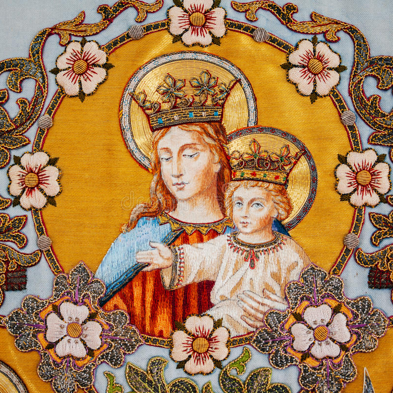 Embroidered religious icon Virgin Mary holding Jesus. Old embroidered religious icon with Virgin Mary holding Jesus stock photos