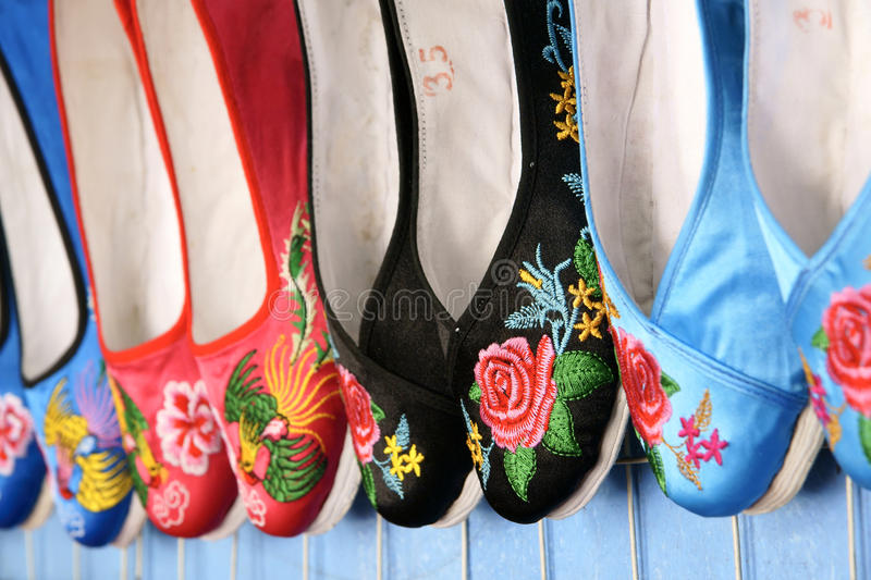 Embroidered shoes. On the market for sale stock photos