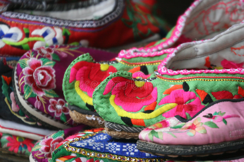Embroidered shoes. Traditional Chinese embroidered shoes. Shot at Lijiang ancient town of Yunnan, China royalty free stock images
