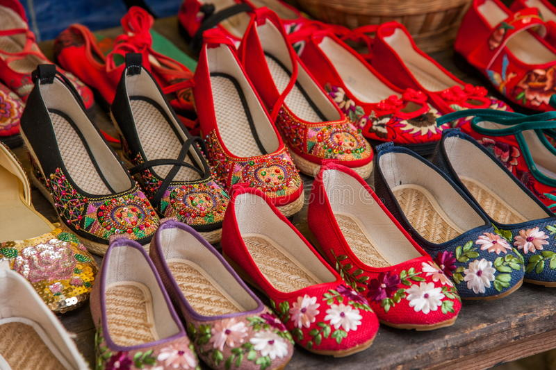 Embroidered shoes Yunnan Dali City stalls on the Dragon. Footwear family, culture and art of embroidery shoe perfect combination of Chinese embroidered shoes are stock photography
