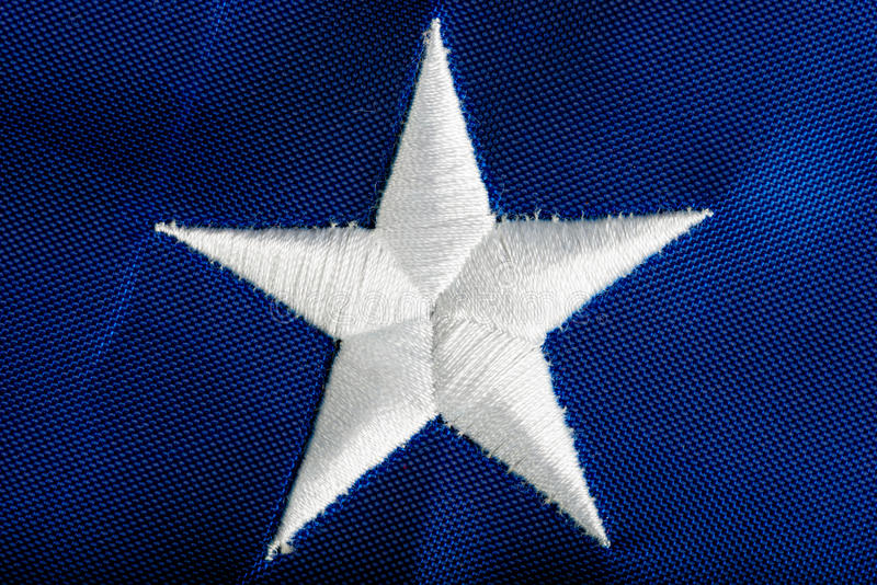 Embroidered star American flag. Macro royalty free stock photography