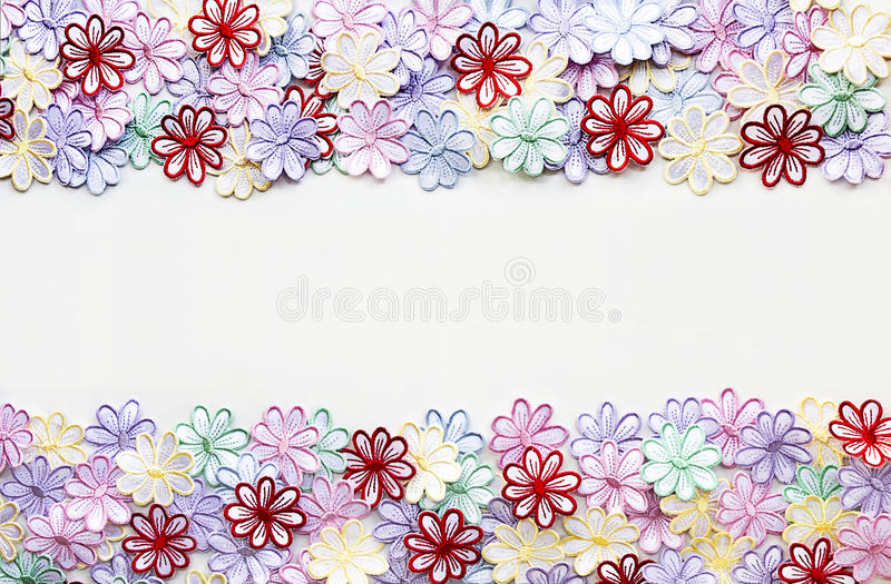 Embroidery colorful flowers pattern texture and background for. Greeting card or wallpaper stock photos