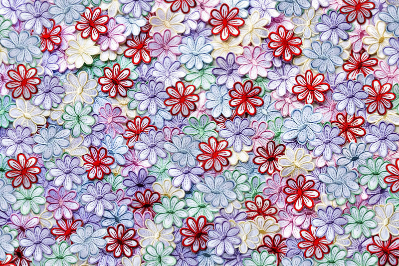 Embroidery colorful flowers pattern texture and background on a. White background for Wedding invitation or greeting card royalty free stock image