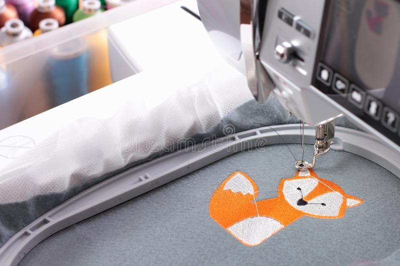 Embroidery with embroidery machine - fox theme stock photography