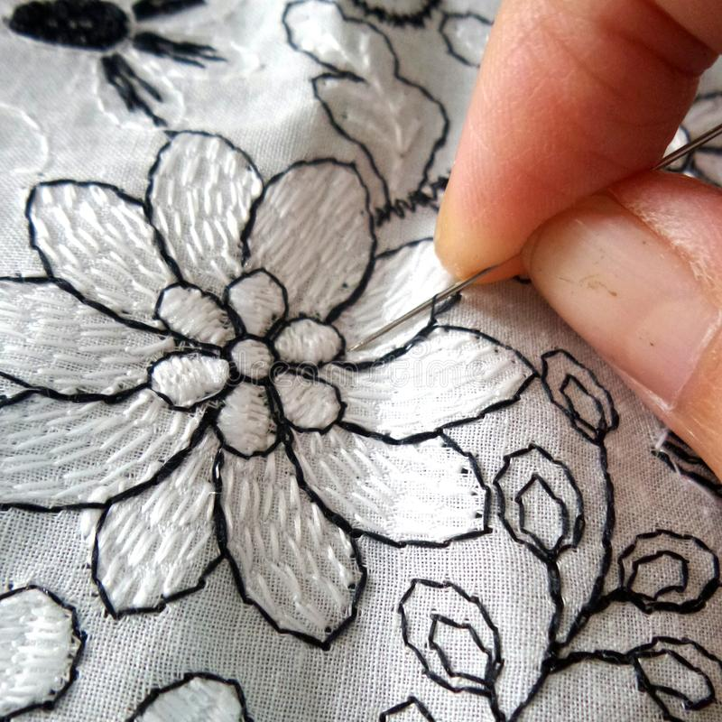 Embroidery embroider. Seamstress finger craft royalty free stock images