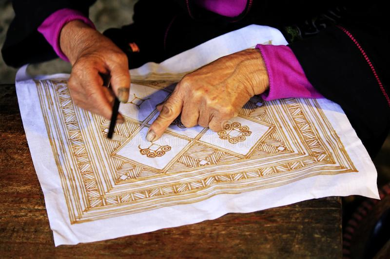 Embroidery by hand in Sapa. Embroidery yarn by hand from the Black Hmong in Sapa town royalty free stock image