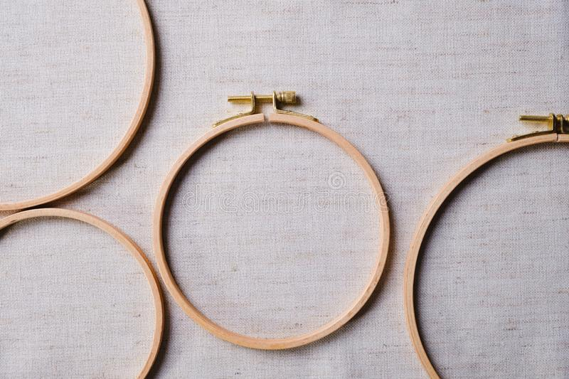 The embroidery hoops for needlework and sewing Flat lay top view of a mockup on canvas. Background stock photography