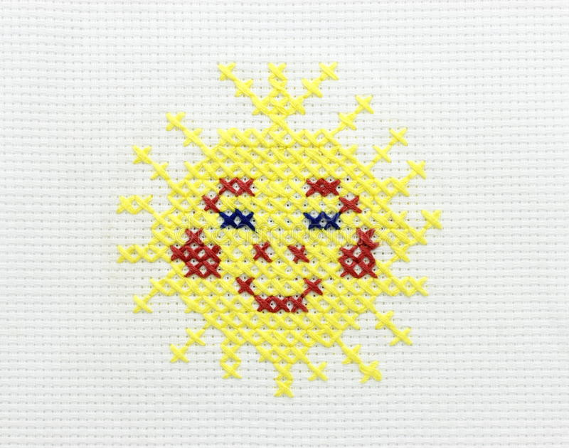 Embroidery Of The Image Of The Sun Royalty Free Stock Photos