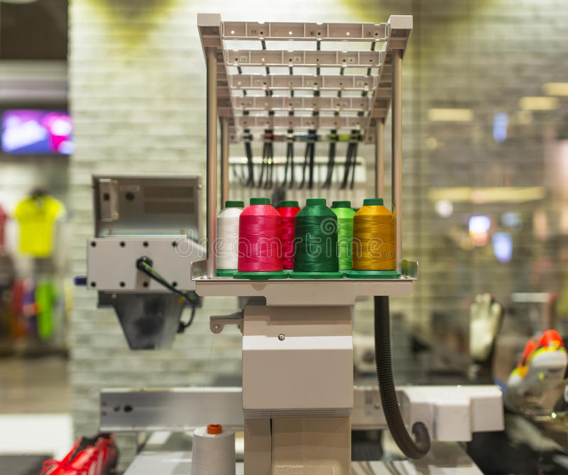 Embroidery Machine. With various color thread inside sport fashion shop royalty free stock photo