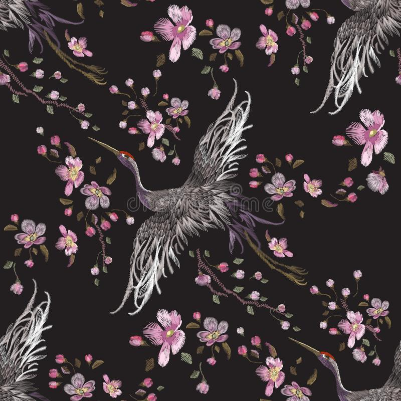 Embroidery oriental seamless pattern with cranes and cherry blossom. Vector embroidered floral patch with bird for clothing design
