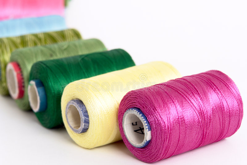 Embroidery yarn bobbins stock photos