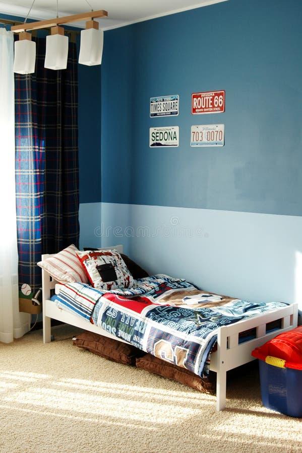 Embroma el dormitorio azul imagenes de archivo