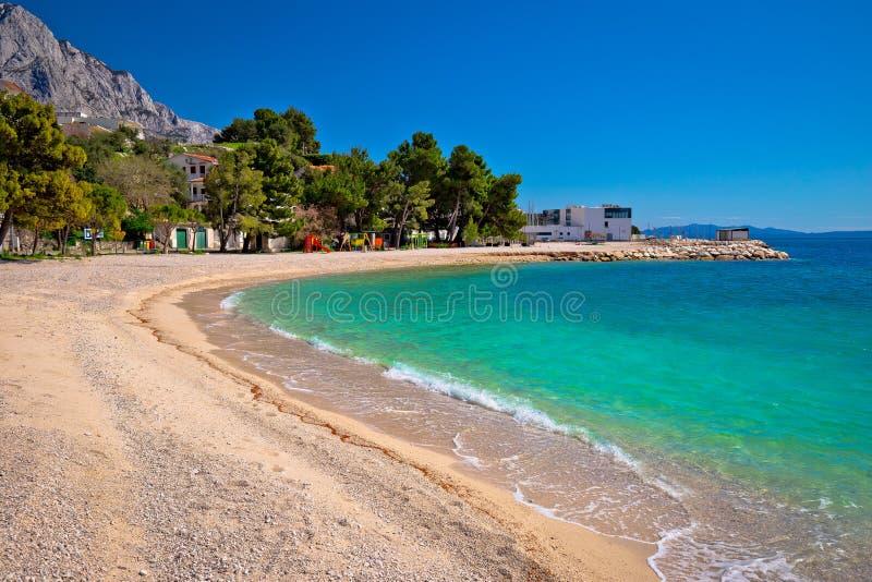 Emerald beach in Brela under Biokovo mountain cliffs view stock image