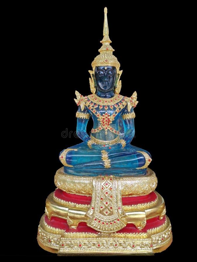Emerald Buddha body blue on black background. royalty free stock image