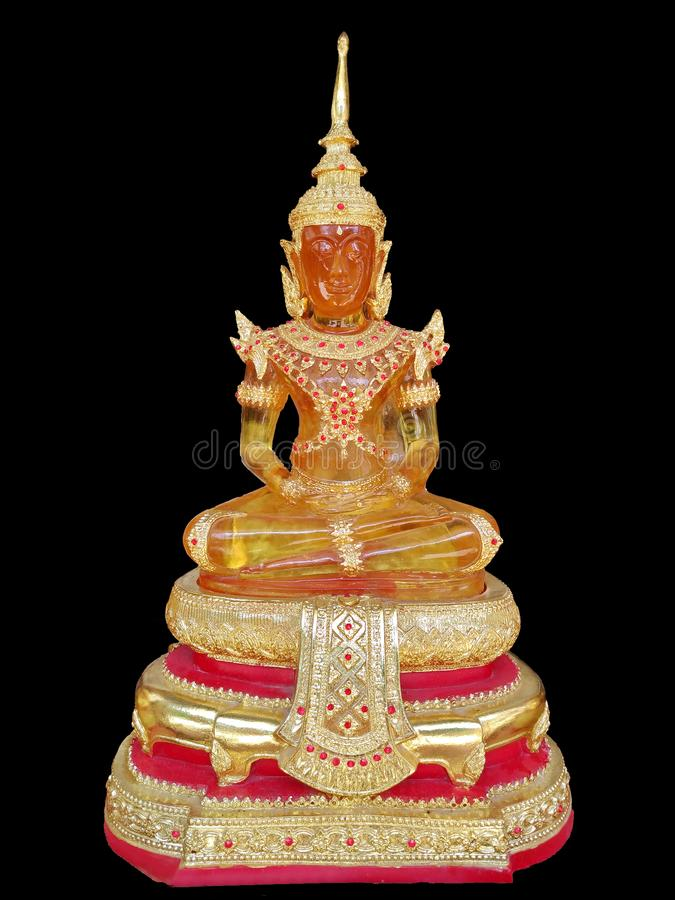 Emerald Buddha body yellow on black background. royalty free stock image