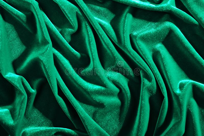 Emerald color velvet textiles for background or texture, wrinkled and shadows royalty free stock photos