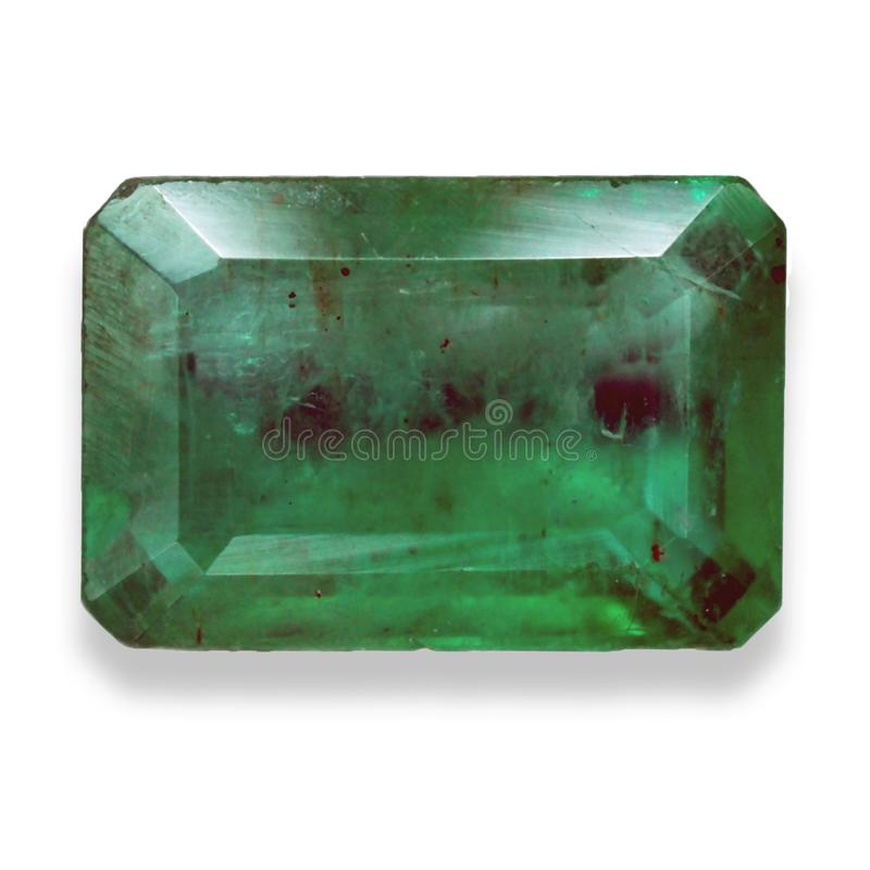 Emerald gemstone with emerald cut. Emerald is gemstone in beryl species. There green color with many inclusion inside. Emerald value as similar ruby and diamond stock image