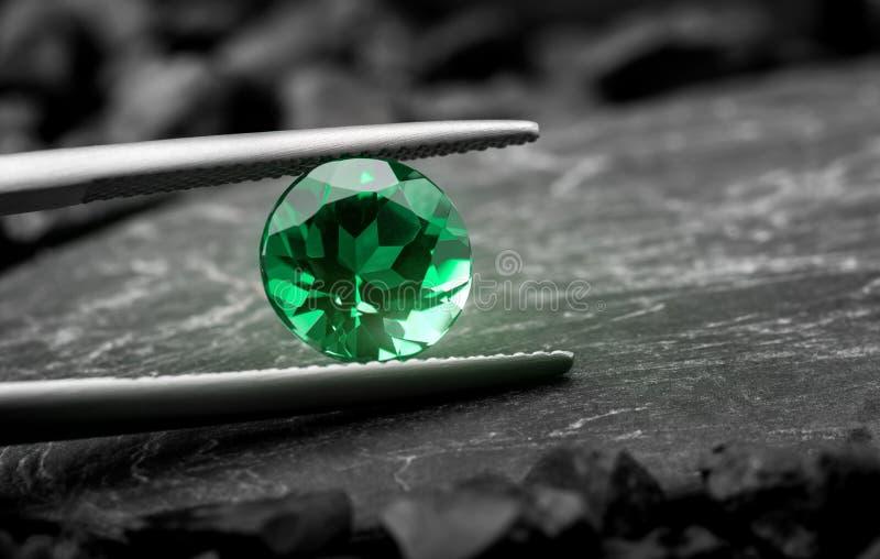 The emerald gemstone jewelry cut. Photo with dark stone background stock photos
