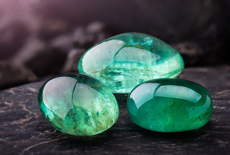 The emerald gemstone jewelry. The emerald gemstone jewelry photo with black stones and dark lighting stock photos