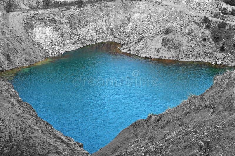 Emerald lake. Blue emerald lake at abandoned quarry of Racos, Romania stock photography