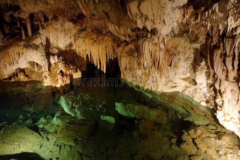 Emerald lake and stalactites in a cave in Slovakia royalty free stock image