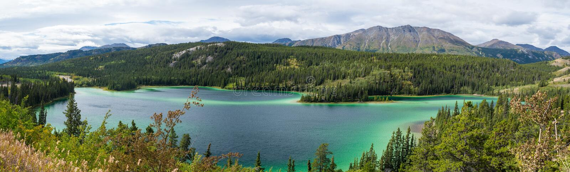 Emerald Lake under cloudy sky in Yukon Canada royalty free stock photos