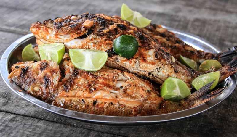 Typical barbecued fish, emerald sea, northern Madagascar. The Emerald Sea Mer d`Emeraude is located north of the passage to Diego Suarez Bay, one of the most royalty free stock photo