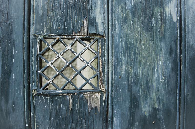 Emerald shabby door Cracked weathered wooden texture. Emerald shabby door Cracked weathered wooden board texture royalty free stock photo