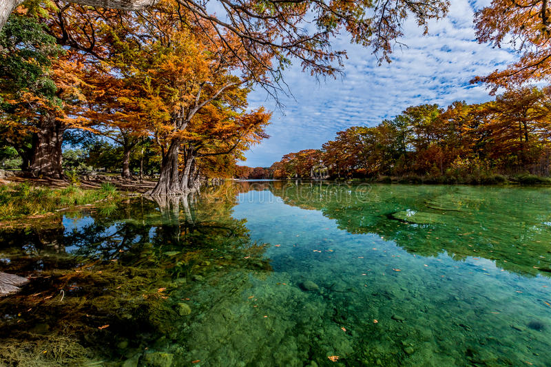 Emerald Water and Bright Fall Foliage at Garner State Park, Texas. Beautiful Bright Fall Foliage Surrounding the Clear Emerald Waters of the Frio River, Texas royalty free stock photography