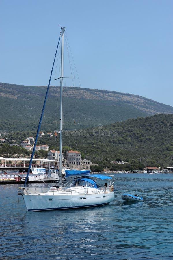 Emerald waters of the Adriatic Sea and pleasure yacht in Boka Kotorska Adriatic Sea bay, Montenegro, Europe. Fantastic beauty of emerald waters of the Adriatic stock photography