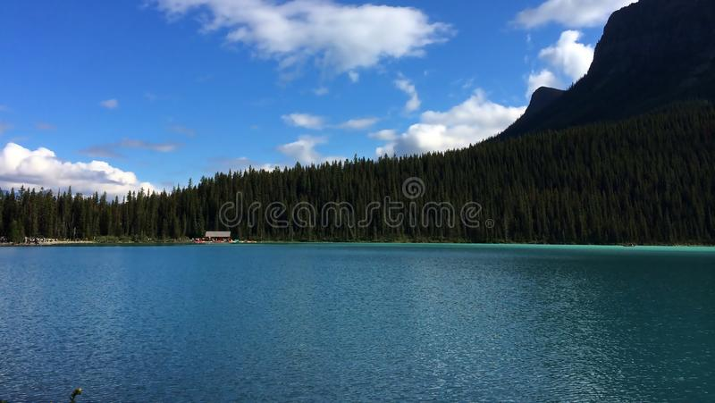 Emerald waters of Lake Louise. Lake Louise, named Lake of the Little Fishes by the Stoney Nakota First Nations people, is a glacial lake within Banff National stock photos
