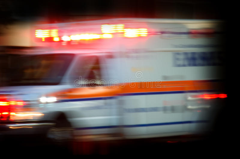 Emergency. EMS (Emergency Medical Services) abstract background blur - lights on rushing to the scene