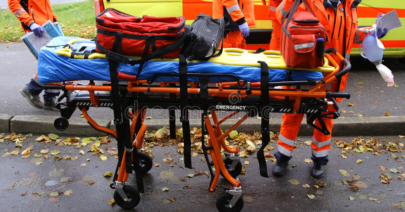 Emergency ambulance rescue stretcher trolleys in acton. Emergency staff ambulance rescue stretcher trolleys equipment breathing mask doctors stock images