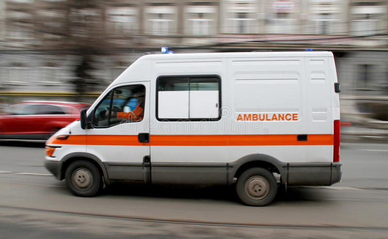 Emergency ambulance rushing. On city street royalty free stock photos