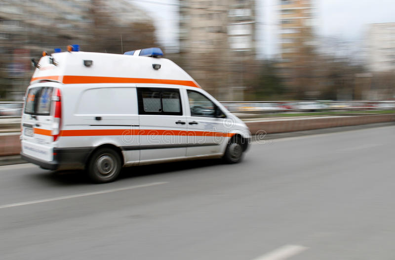 Emergency ambulance. Speeding on city street stock photography