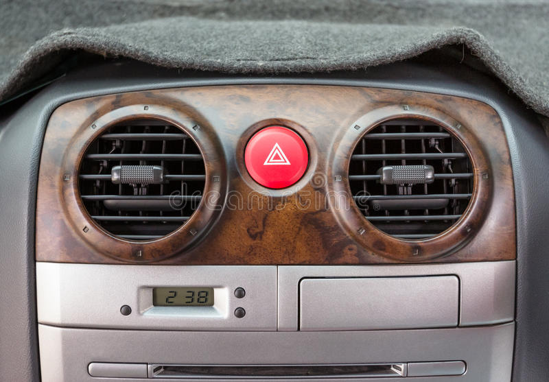 Emergency button in car with air vents.  royalty free stock photo