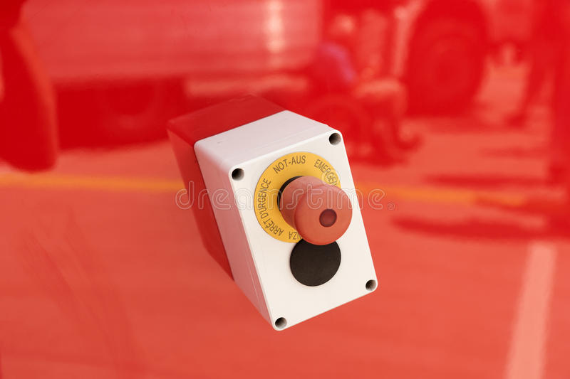 Emergency button on red background stock images