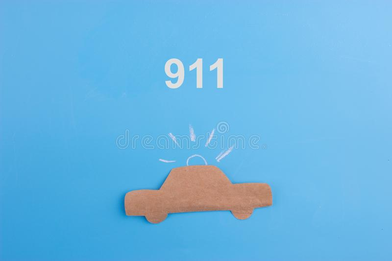 Emergency car concept. Paper car on blue background stock illustration